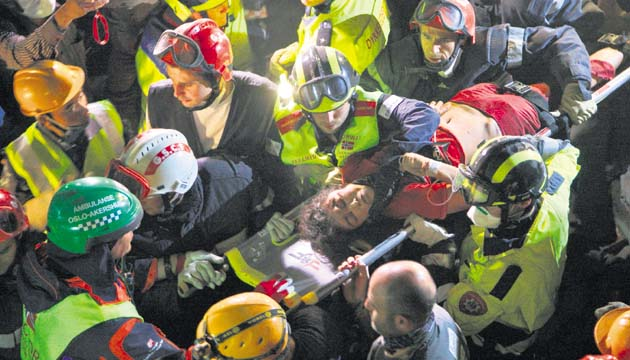 Krishna Devi Khadka is carried on a stretcher after being rescued from a building that collapsed in Saturday's earthquake in Kathmandu, Nepal, Thursday, April 30, 2015. Police in Kathmandu confirmed that rescuers dug out Khadka, a woman in her 20s from the debris of Saturday's massive quake. (AP Photo/Bikram Rai) ---------- color